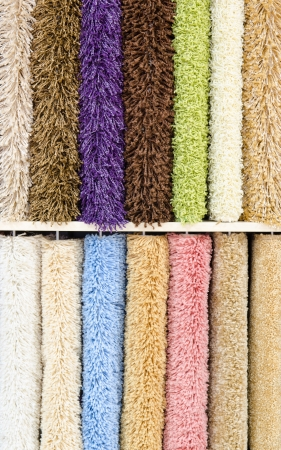 showpiece: different colourful artificial shaggy carpet samples, closeup