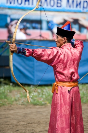 naadan: ULAN-UDE, RUSSIA - JULY 16  The 4th General Session of the World Mongolians Convention  An unidentified archer takes part in Mongolian archery competition, July 16, 2010 in Ulan-Ude, Buryatia, Russia