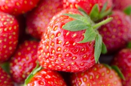 super macro: fresh ripe garden strawberries, a macro shot