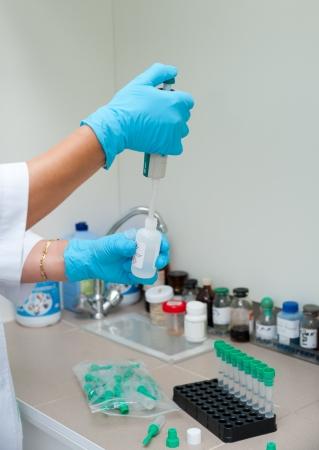 a nurse makes an analysis at a clinic laboratory Stock Photo - 14654617