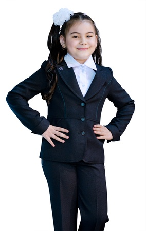 seven years: a smiling seven year old girl in a dark blue uniform, isolated Stock Photo