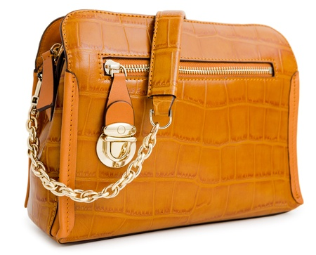 a brown ladies handbag, isolated over white