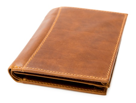 genuine good: a brown leather wallet, over white background