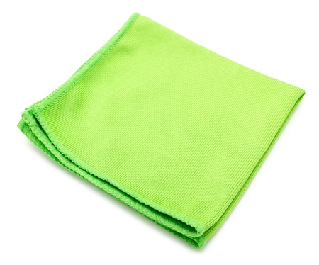 hardwearing: a green microfiber cleaning towel, over white background