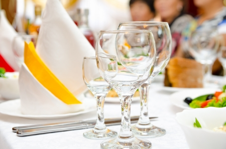 served: place setting at laid restaurant banquet table Stock Photo