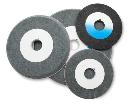 stone cutter: some abrasive disks of different diameters, over white