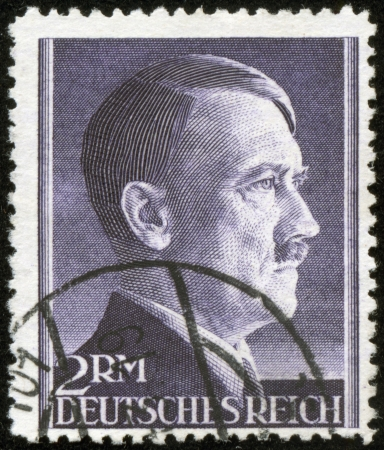fascist: GERMANY - CIRCA 1943  A stamp printed by the fascist Germany Post is a portrait of Adolf Hitler, circa 1943 Stock Photo