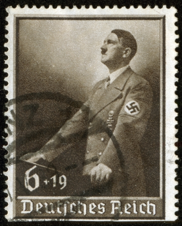 fascism: GERMANY - CIRCA 1939  A stamp printed by the fascist Germany Post is a portrait of Adolf Hitler, circa 1939