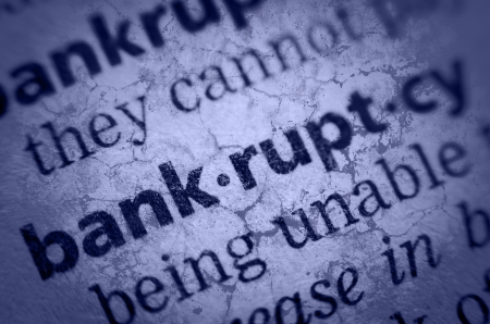 glossary: the word bankruptcy in an English glossary, super macro, collage with grunge texture Stock Photo
