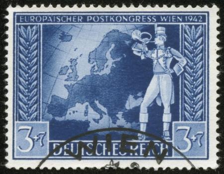 reich: GERMANY - CIRCA 1942  A stamp printed by the fascist Germany Post is entitled  Europaischer Postkongress Wien 1942   European Post Congress Vienna 1942 , circa 1942