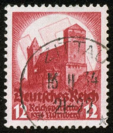 fascist: GERMANY - CIRCA 1934  A stamp printed by the fascist Germany Post is entitled  Reichsparteitag 1934 Nurnberg   Imperial party convention , circa 1934 Editorial