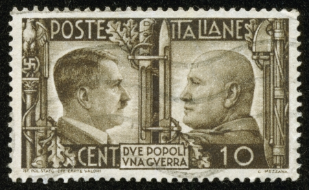 fascist: ITALY - CIRCA 1941  A stamp printed by the fascist Italy Post is a portrait of Adolf Hitler and Benito Mussolini  It is entitled  Due popoli una guerra   Two nations one war , circa 1941