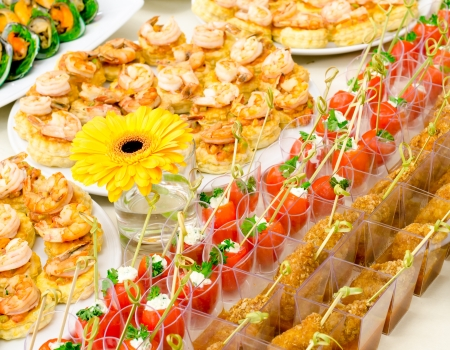 prawn skewers: a lot of seafood cold snacks on buffet table, catering