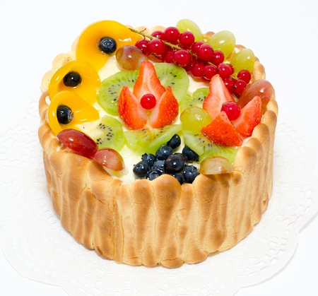 fresh fruit and berries on whipped cream in a sponge basket photo