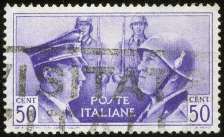 fascist: ITALY - CIRCA 1941  A stamp printed by the fascist Italy Post is a portrait of Adolf Hitler and Benito Mussolini, circa 1941