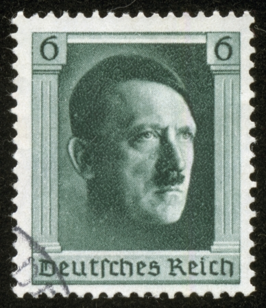 hitler: GERMANY - CIRCA 1937  A stamp printed by the fascist Germany Post is a portrait of Adolf Hitler, circa 1937