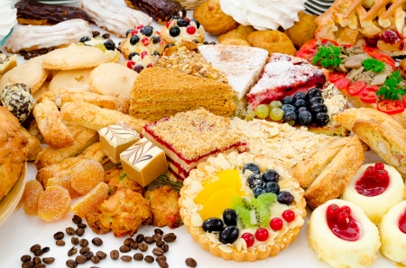 shallow focus: many different kinds of dessert - cakes, sweets and pies