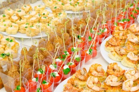 buffet table: a lot of cold snacks on buffet table, catering