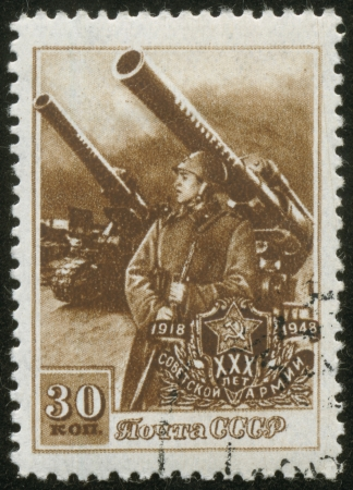 agitation: SOVIET UNION - CIRCA 1948  A stamp printed by the Soviet Union Post is entitled  30 years to the Soviet Army   It shows a artilleryman by antiaircraft guns, circa 1948