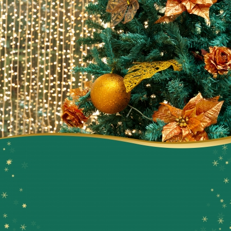 Christmas tree decorated with gold, green copy space photo