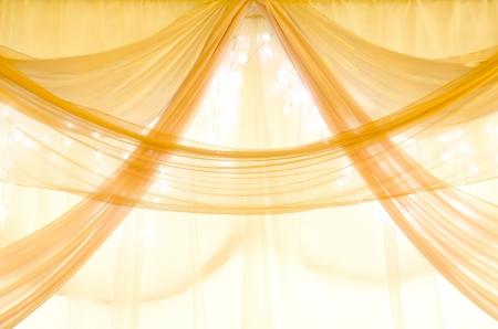 golden curtains on a window with illumination