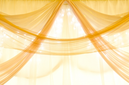 organza: golden curtains on a window with illumination