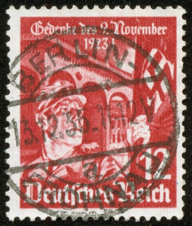 fascist: GERMANY - CIRCA 1935  A stamp printed by the fascist Germany Post is entitled  Do not forget November 23, 1923    It shows a soldier with a fascist banner, circa 1935 Editorial