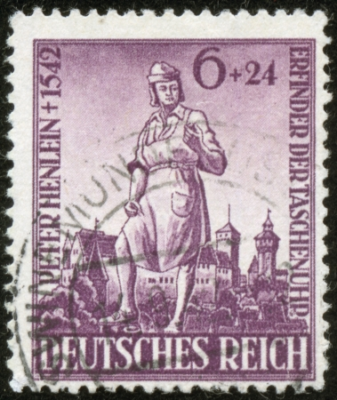 fascist: GERMANY - CIRCA 1942  A stamp printed by the fascist Germany Post is entitled  Peter Henlein  1542 Inventor of watch , circa 1942 Editorial