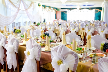 a restaurant banquet room decorated for a wedding party photo