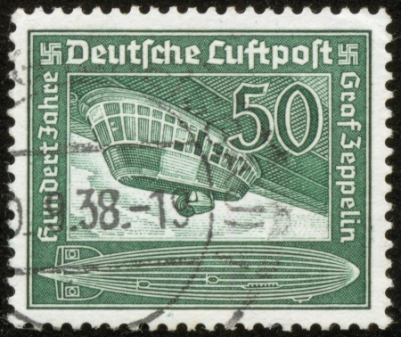 german fascist: GERMANY - CIRCA 1938  A stamp printed by the fascist Germany Post is entitled  German airmail  Count Zeppelin  A hundred years  , circa 1938
