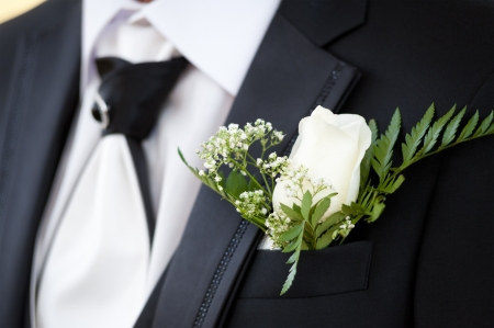 bridegrooms: a buttonhole at a bridegrooms jacket, closeup
