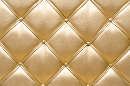 fine gold: golden leather upholstery, a closeup shot