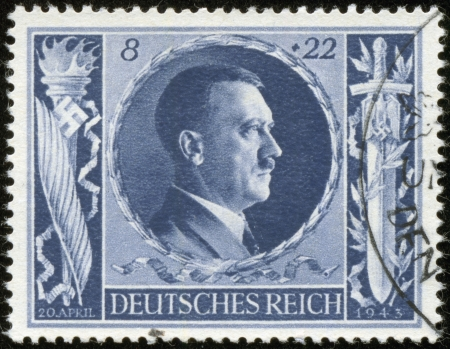 adolf: GERMANY - CIRCA 1943  A stamp printed by the fascist Germany Post is a portrait of Adolf Hitler, circa 1943 Editorial