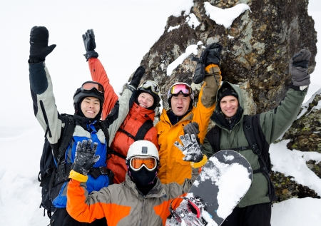 30 40: a group of happy snowboarders high in mountains