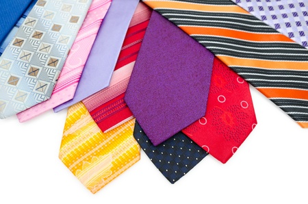 haberdashery: many different colurful mens ties, over white