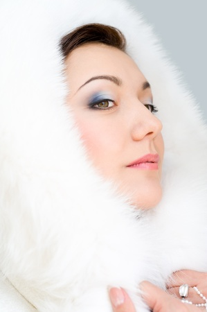 young brunette woman in white fur hood Stock Photo - 17364790