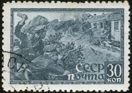 fascist: SOVIET UNION - CIRCA 1943  A stamp printed by the Soviet Union Post is entitled shows Russian soldiers attacking a fascist train, circa 1943