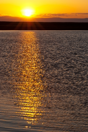 Baikal sunset - sun goes down over water Stock Photo - 17549271