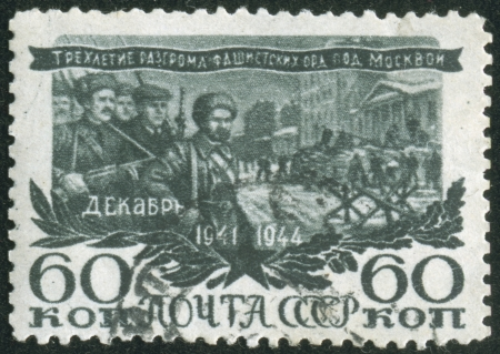 fascist: SOVIET UNION - CIRCA 1944  A stamp printed by the Soviet Union Post is entitled  The third anniversary of defeat of fascist hordes under Moscow   It shows Russian soldiers, circa 1944