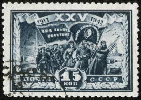 SOVIET UNION - CIRCA 1942  A stamp printed by the Soviet Union Post is entitled  All power to soviets  Death to german invaders   It shows Russian soldiers with banners, circa 1942 Stock Photo - 17808507