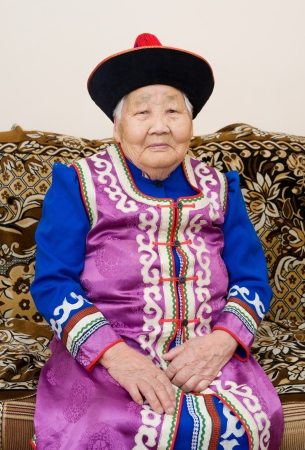 the great grandmother: buryat  mongolian  great grandmother and grandson, in national costumes