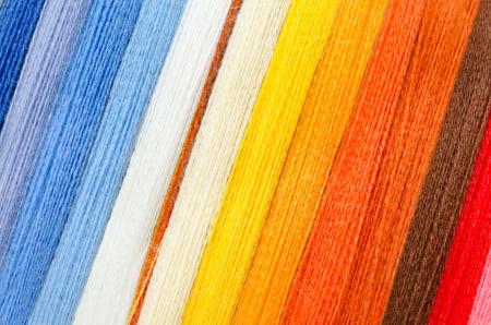 stitchcraft: woolen colorful threads - blue, white, yellow, orange, brown, red Stock Photo