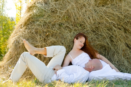 haystack: loving couple - wife and husband look at each other