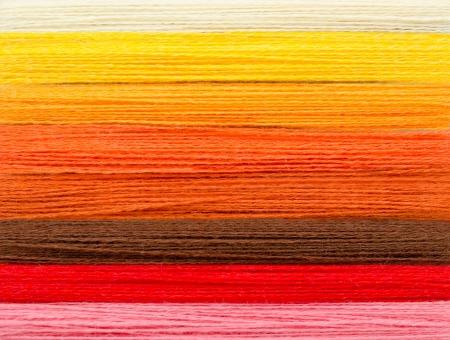 stitchcraft: woolen colorful threads - white, yellow, orange, brown, red, pink