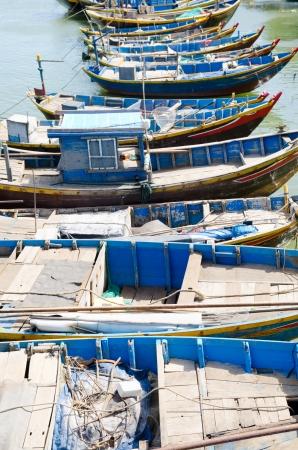 fishery: line of wooden blue fishing boats in Vietnam