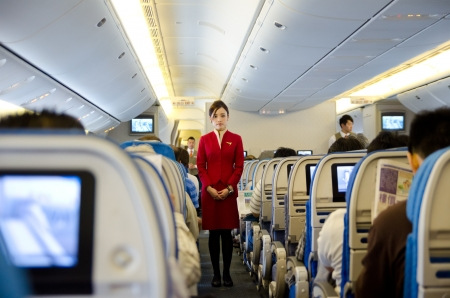 HO CHI MINH CITY, VIETNAM - MARCH 8  Unidentified stewardess of Cathay Pacific Airways gives preflight instructions at the flight to Hong Kong, March 8, 2013, Ho Chi Minh City, Vietnam  報道画像