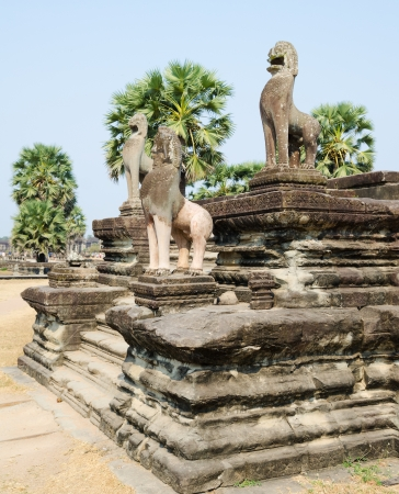 stone statues of lions in Angkor, Cambodia photo