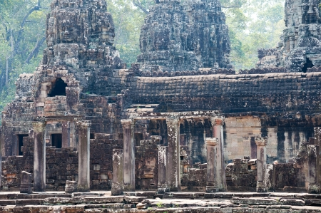 Bayon is a temple complex in Angkor Thom  It is famous with about 200 faces of Avalokitesvara, a buddhist deity Stock Photo - 18957107