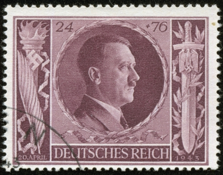fascist: GERMANY - CIRCA 1943  A stamp printed by the fascist Germany Post is a portrait of Adolf Hitler, circa 1943 Editorial