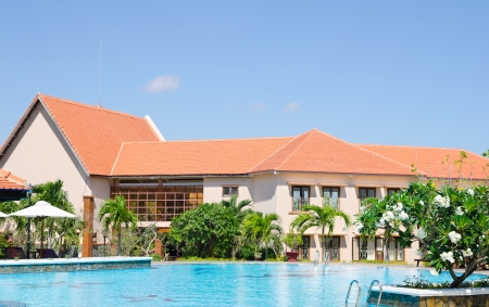 oitdoor swimming pool in front of hotel, on sunny day Stock Photo - 19106962